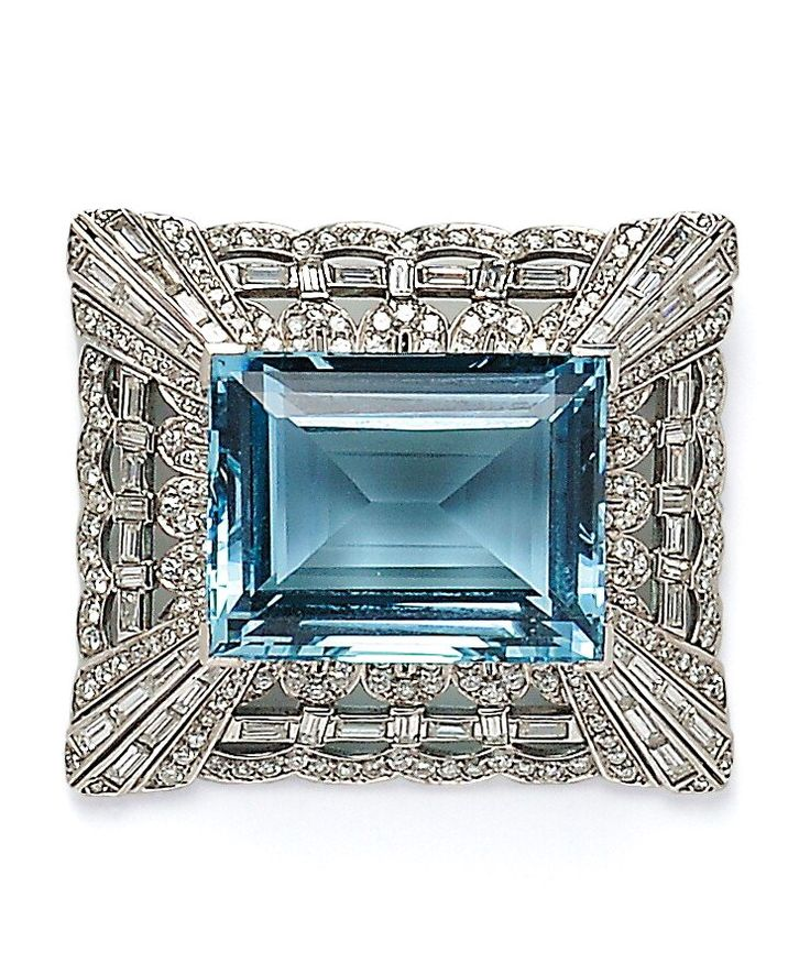 Platinum, Aquamarine, and Diamond Brooch, the large step-cut aquamarine measuring approx. 28.00 x 22.00 x 13.70 mm, and weighing approx. 60.00 cts., within a scalloped mount set with baguette- and full-cut diamonds, approx. total wt. 6.50 cts., lg. 1 3/4 in.
