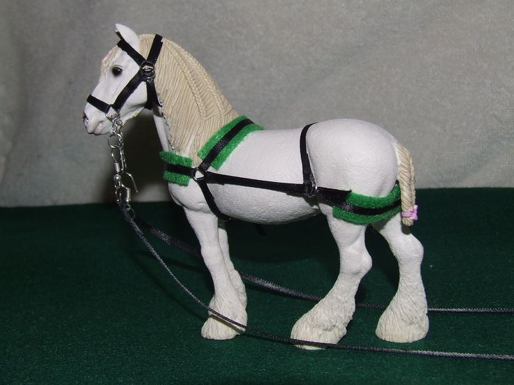 DIY Harness and driving bridle. Made of black ribbon, jewelry loops, chain, felt, and superglue. Can be made functional when hooked to the tongue of a wagon or cart.
