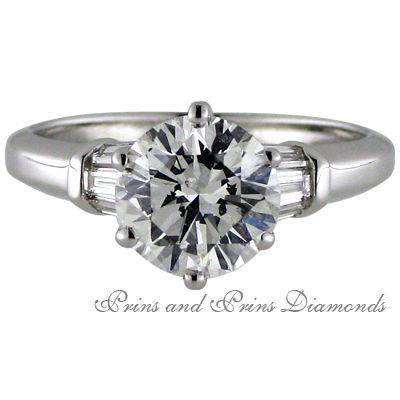 Round brilliant cut diamond with baguette diamonds in the band.