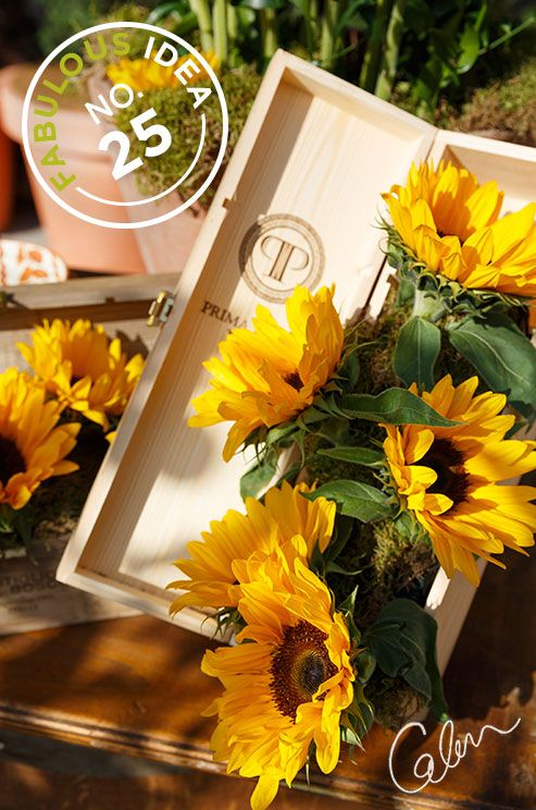 Fabulous Idea No.25: A wine box is fashioned into a rustic decor piece with the addition of bright sunflowers.