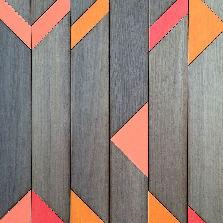 Inlaid wood surface by Anthony Roussel. Marquetry inspired. Applied as decorative wall panels and table tops. #orange #inlaidwood #inlay #wood #marquetry #panelling #paneling #tabletops #wood #metier