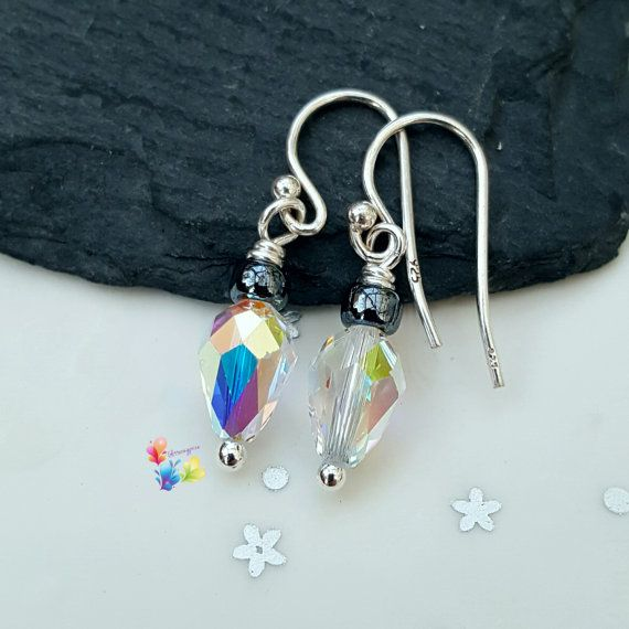 Crystal Drop Earrings Christmas Fairy by GlitteringprizeGlass  🌟 Christmas Fairy Light Earrings!🌟  Made with clear multi-faceted bulb shaped Swarovski crystals with an AB coating ... giving these a happy Christmas feel! With sterling silver french wires.  #glitteringprizeglass #fairylights #christmas #crystal #earrings #giftforher #bulb #holidaygift #stockingfiller #sterlingsilver