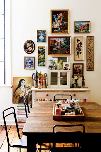 Dishfunctional Designs: Create An Eclectic Gallery Wall -- A collection of vintage prints and needlepoint ......... I think the oval frame make these prettier.