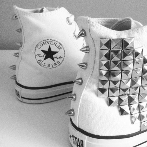 White Converse high top sneakers with silver pyramid studs at sides and silver cone spikes along back.. DIY the look yourself: http://mjtrends.com/pins.php?name=studs-and-spikes-for-sneakers