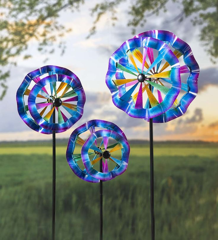Colorful Ruffled Wind Spinners, Set of 3   Wind Spinners - Add instant impact to your yard with our set of 3 Ruffled Wind Spinners. All three spinners (small, medium and large) feature double-pinwheels with ruffled edges that capture even the lightest breezes to produce a mesmerizing motion.
