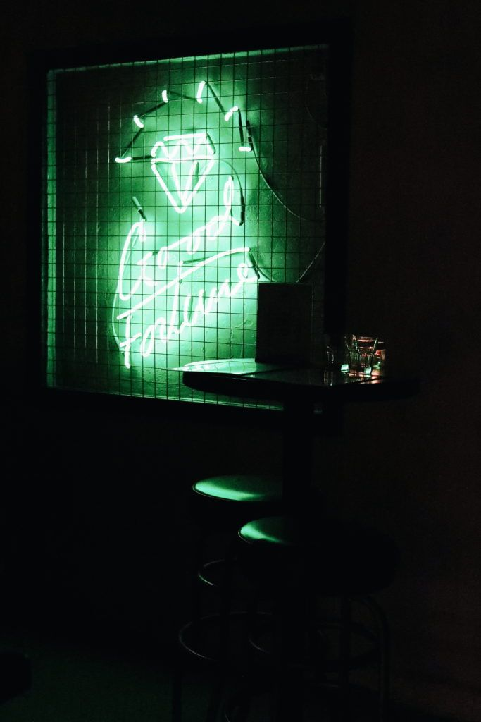 Good Fortune Bar: Interior seating + neon sign
