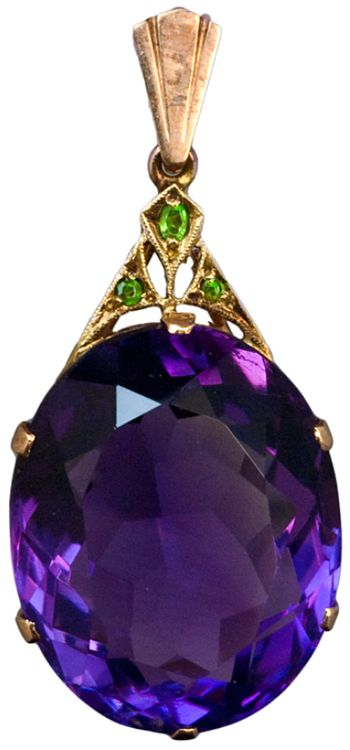 Art Deco Siberian Amethyst Pendant c. 1930. An Art Deco Siberian Amethyst, Demantoid Garnet and Rose Gold Pendant. The pendant features an oval cut large Siberian amethyst with an approximate weight of 30,5 carats. The Art Deco gold mount is set with three Uralian demantoids. Via 1stdibs.