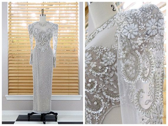 This is an exquisite vintage gown by Lillie Rubin. Its beautifully detailed and hand beaded with sequins and beads. Its in perfect condition! Bust - 32 Waist - 26 Hips - 35 Shoulders - 15 Sleeves - 26 Total Length - 56 Tag Size - 4 This dress comes from a pet-free and smoke-free home. If