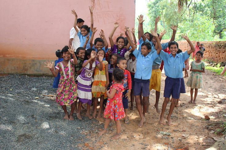 Rural Kids are posing for photograph. photo copyright@ Kumar