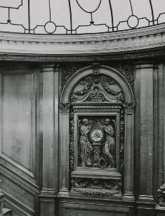 Wood carving and clock on the grand staircase of the Titanic  http://www.titanicandco.com/inside.html