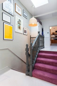 This small, tight stairway area is brightened up and given interest with a skylight and colorful artwork.