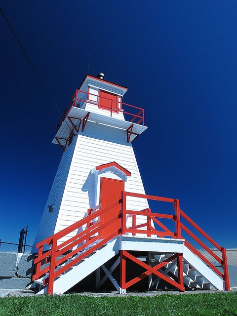 Fort Amherst Lighthouse shows off its new paint on a sunny Sunday afternoon, Fort Amherst, St. John's, Newfoundland & Labrador