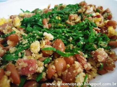 Feijão tropeiro, cattleman's beans. Beans, bacon, pepperoni, chopped kale and manioc flour.