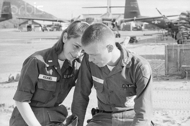 9/13/1965 - Qui Nhon, South Vietnam - Lieutenant Kathleen Rockwell, 23, of Alexandria, Virginia, an army nurse, leans on the shoulder of her husband, Lieutenant Richard Rockwell, 23, of New York City. Kathleen managed to get herself transferred here to be with her husband, arriving last week in time to get a field hospital set up, only to discover that Richard was being sent back to the front lines at Cam Ranh Bay.