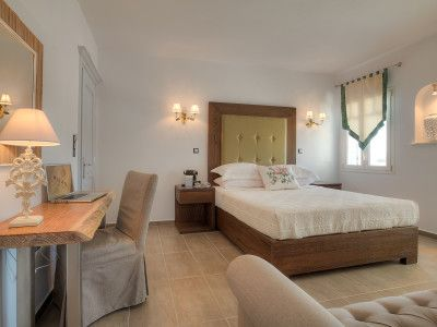 Modern comforts offered for relaxation and warmth.  #greece #hotel #holidays #suites