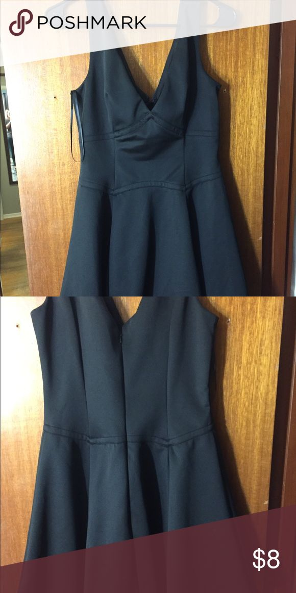 Forever 21 v neck dress Black forever 21 dress v neck cut on front and back. Size large. Will be listed till January 15, 2018 then off to donation if not purchased. Falls about high mid thigh. Forever 21 Dresses Midi