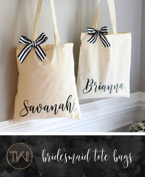 Bridesmaid tote bags personalized with the name of your choice are great for packaging the bridesmaid and wedding party gifts! This tote bag features your bridesmaids name in a script lettering. Fill them with tumblers, a personalized hanger and bridesmaid robe - the perfect gift!  - Details - - This listing is for 1 personalized tote - Natural Color Tote - Black and white ribbon will be included, bow will need to be tied to bag - 15 x 16  Please view our other items shown here: >> Hang...