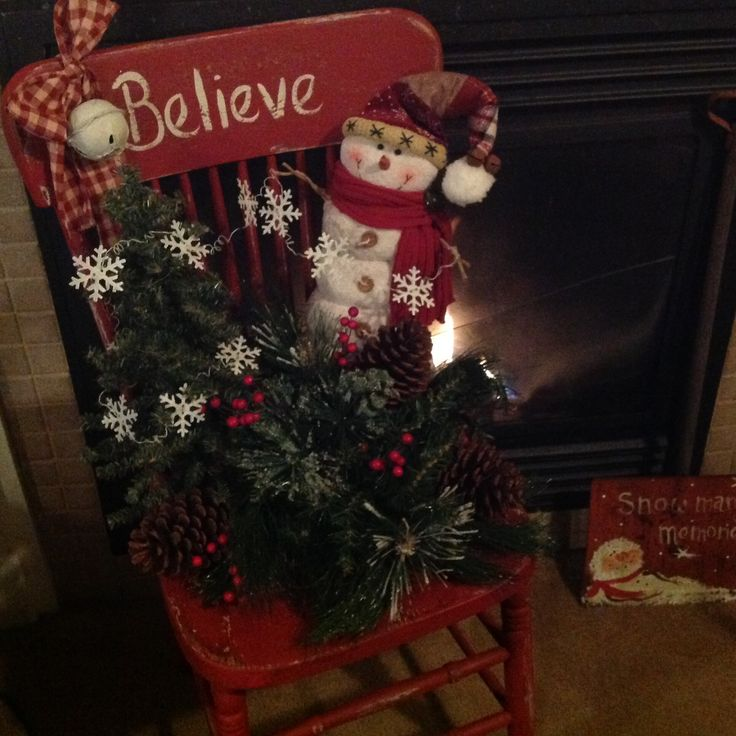 Snowman w/floral's and lights on old chair Calico Cottage