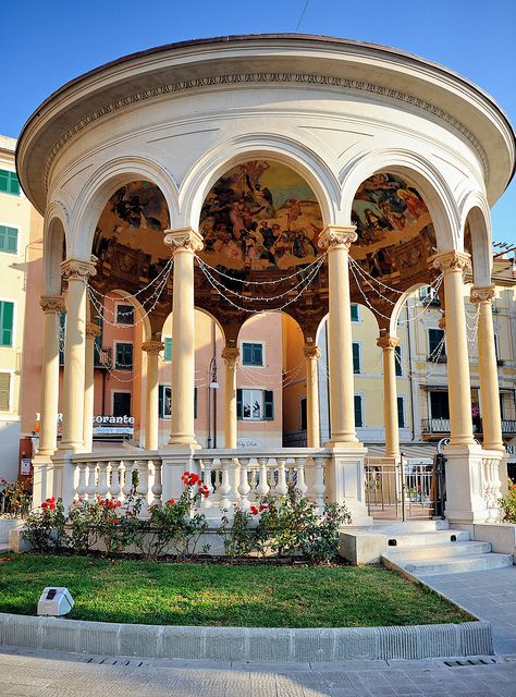 """Rapallo, Italy - This is the Chiosco della Musica (literally """"music kiosk""""). One night my boyfriend and I just laid on the floor and stood there in silence looking at the affresco painted on the ceiling. It was so peaceful, plus the sea is located just in front of the kiosk so you can imagine how relaxing it was to lay there with the calming sound of the waves..."""