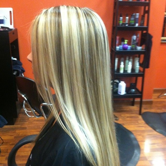Very long platinum blonde with high and low lights