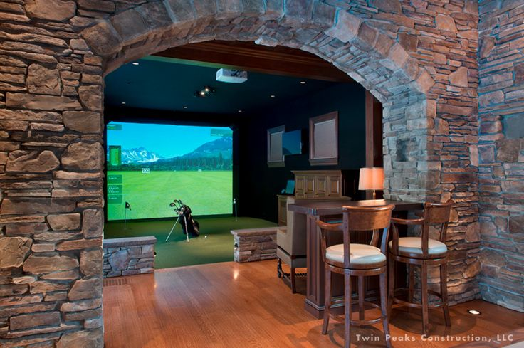 For the dad who loves golf...Get a golf simulator installed in his man cave. (Project by Twin Peaks Construction)