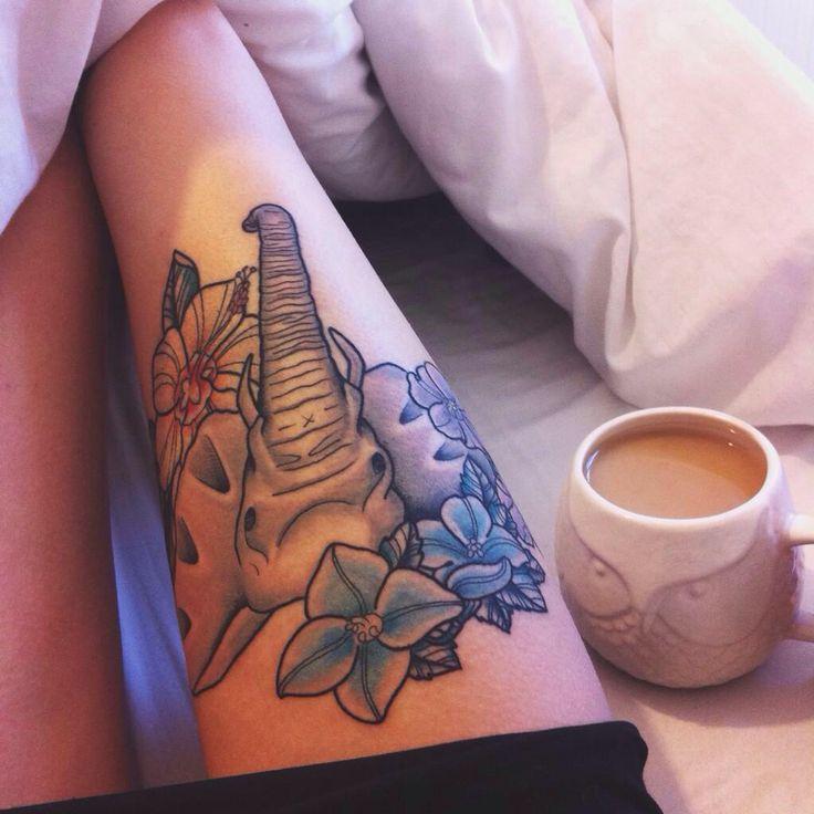 Elephant thigh tattoo