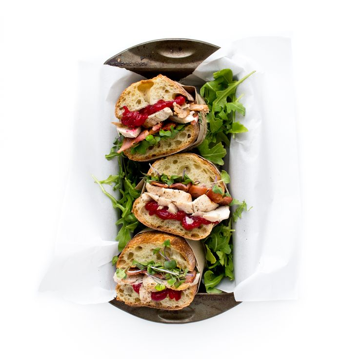 Want to know what to do with your Thanksgiving leftovers? This. The ultimate turkey sandwich layered with mayo + dijon + bacon + turkey + goat cheese + sprouts + arugula + homemade cranberry sauce! Bon appétit! www.chefsouschef.com