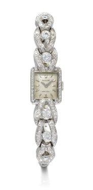 Lady's 18K White Gold and Diamond Bracelet Watch, Rolex, circa 1940