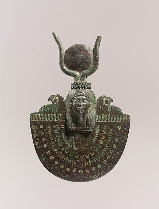 An aegis of Isis ~ Late Period Dynasty: Dynasty 26–30 Date: 664–343 B.C. Geography: Egypt Medium: Bronze or copper alloy, green glass, blue glass
