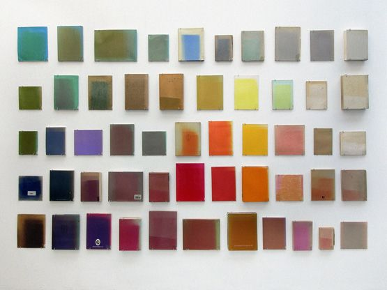 Installation of 53 sun-bleached library books from the Gerrit Rietveld Library collection by Marianne Viero and Laurenz Brunner.