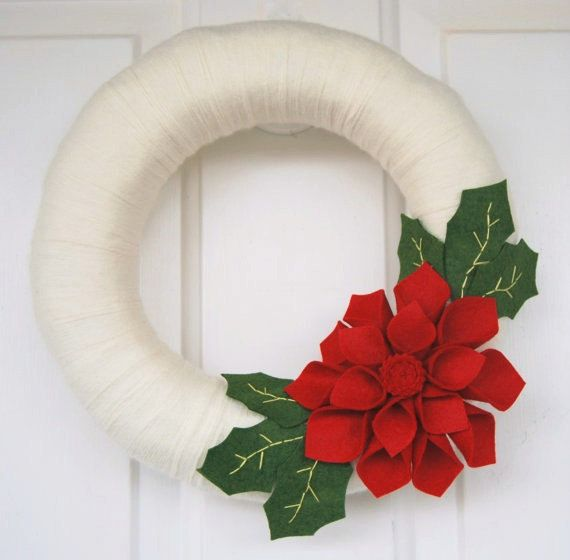 This gorgeous wreath is just what you need to add modern holiday cheer to your door or wall! The straw wreath base is wrapped in a creamy off-white
