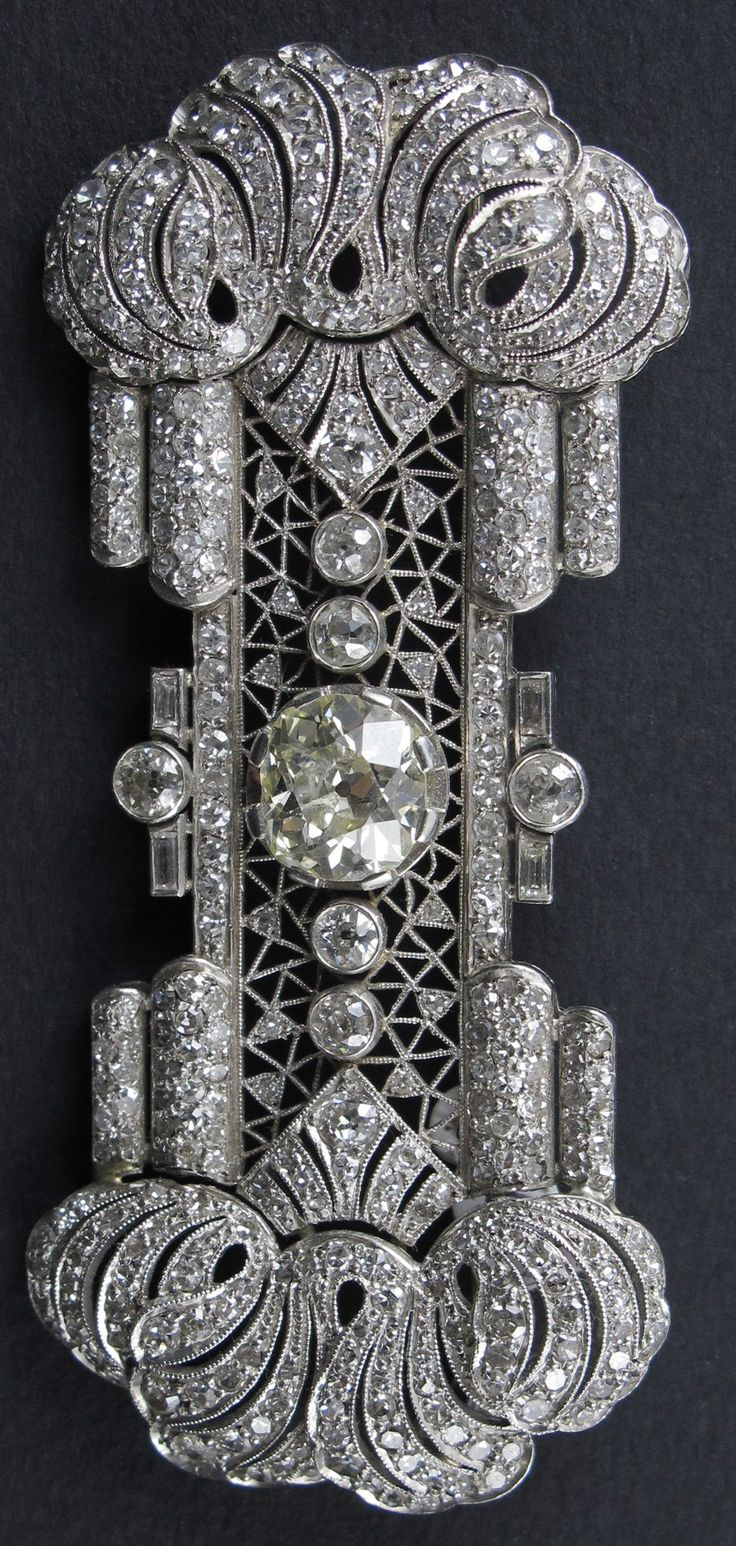 An Art Deco platinum and diamond brooch, French, circa 1920. #ArtDeco #brooch