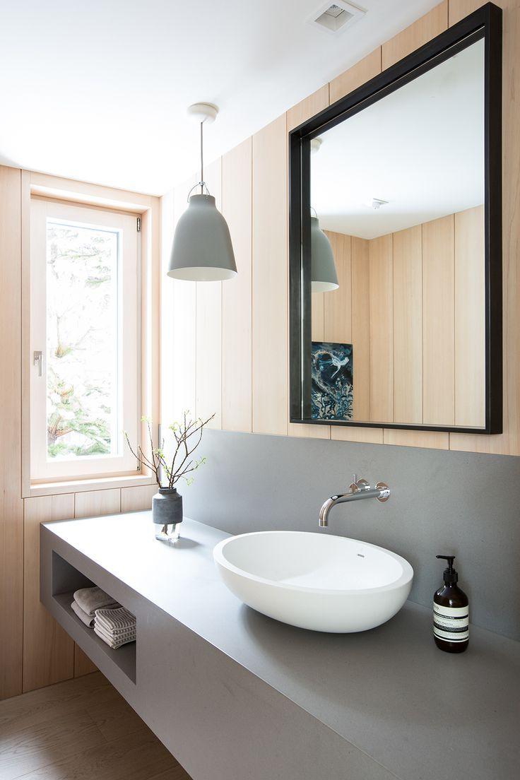 Concrete floating bathroom vanity unit with white oak paneling ...