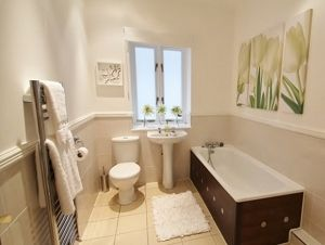The wooden dado rail was painted white and accessories were hired to improve this bathroom for selling the house.