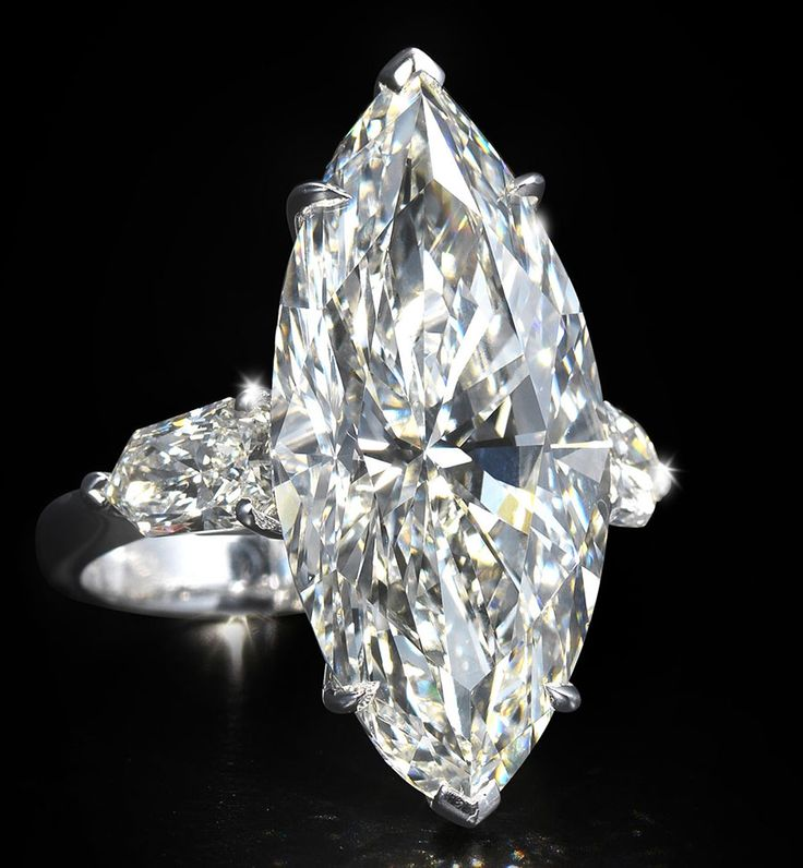 A diamond single-stone ring The marquise-cut diamond, weighing 13.41 carats with remaining diamonds approximately 1.25 carat total.