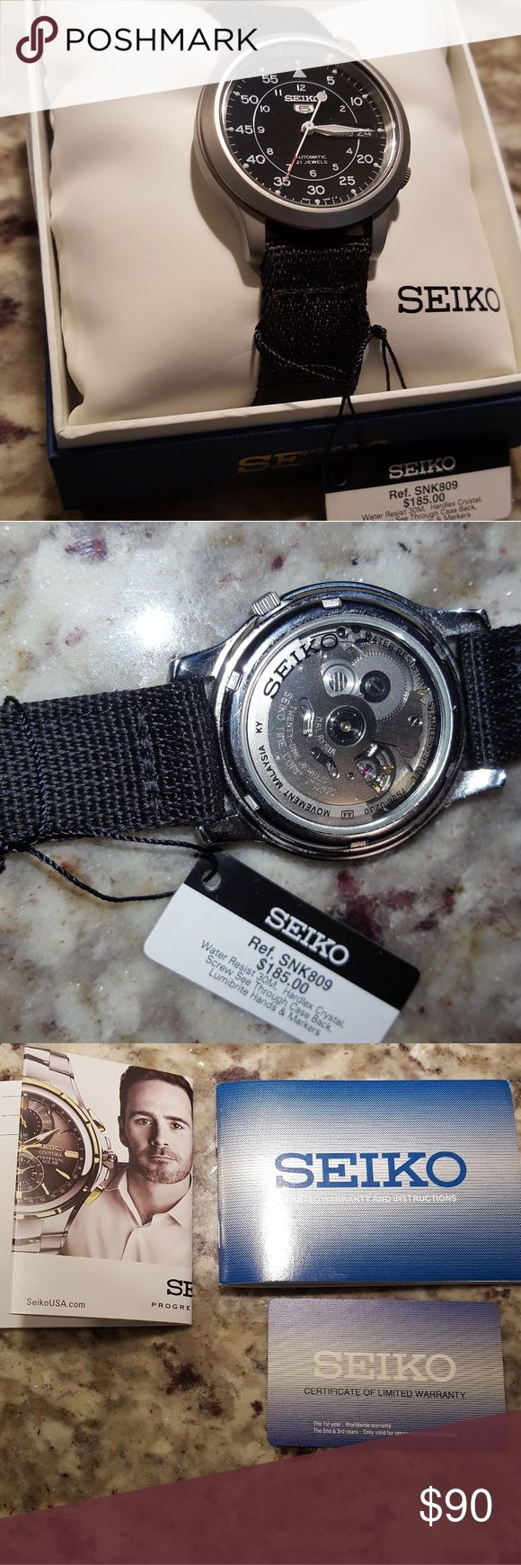 Seiko automatic watch w/ box & papers Stainless steel case with a black canvas bracelet. Fixed stainless steel bezel. Black dial with luminous hands and Arabic numeral hour markers. Arabic numeral minute markers (at 5 minute intervals). minute markers around the outer rim.  Luminescent hands. Day of the week and date display at the 3 o'clock position. Seiko Caliber 7S26 automatic movement with about 40 hours of power reserve. Scratch resistant hardlex crystal. (suitable for snorkeling, as…