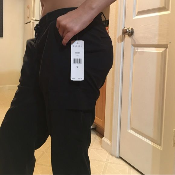 "Lauren Ralph Lauren pants New with tags. Black. Slide slant pockets. Zip, button and drawstring. Flat Cargo style pockets on sides. Jogger pant style pant with drawstrings at ankles. 32"" waist. Just slight stretch. 30"" inseam Lauren ralph lauren Pants"