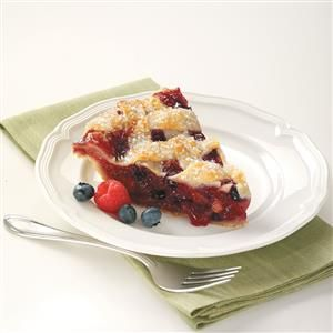Flaky Bumbleberry Pie Recipe -This pie recipe makes one of the flakiest crusts ever. The filling is also delicious with the different berries and rhubarb. This pie is sure to impress.—Suzanne Alberts, Onalaska, Wisconsin