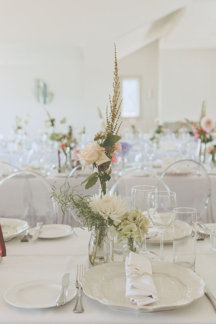 reception tables: antique bottles filled with fresh blooms