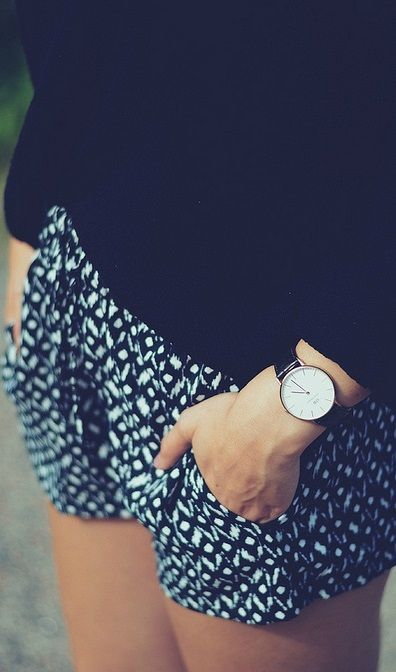 printed black and white shorts, black sweater and simple watch. The right look for a windy afternoon at the beach.