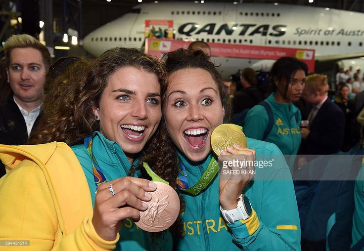 Australian Olympic team members Jessica Fox (L) and Chloe Esposito display their…