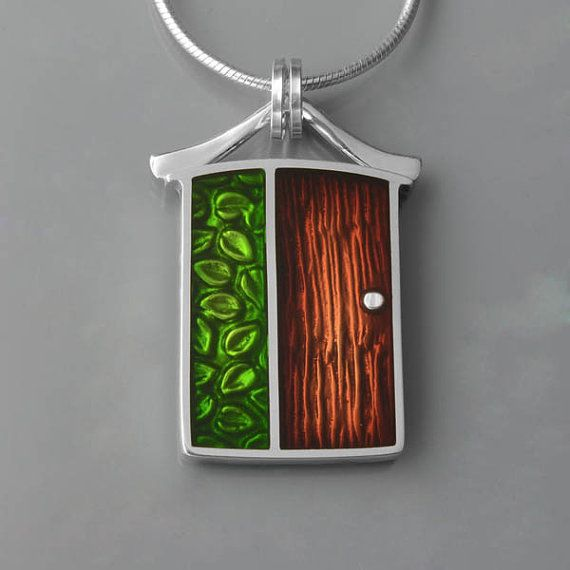 Another beautiful epoxy resin piece by Ivywoodrose on Etsy.  This door pendant is made from precious metal clay - $135.00