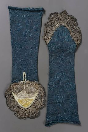 Pair of woman's mitts  Italian, 18th century  Italy  DIMENSIONS  34.3 x 10.5 cm (13.5 x 4.125 in.)  MEDIUM OR TECHNIQUE  Silk knit nit, lace  CLASSIFICATION  Costumes  ACCESSION NUMBER  38.1253a-