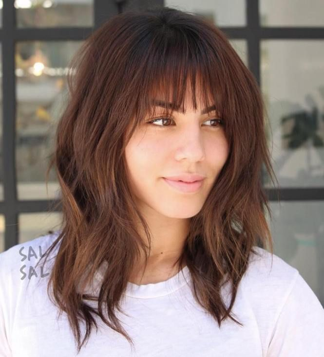Medium Layered Hairstyle With Bangs