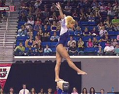 Danusia Francis with a side aerial on the balance beam
