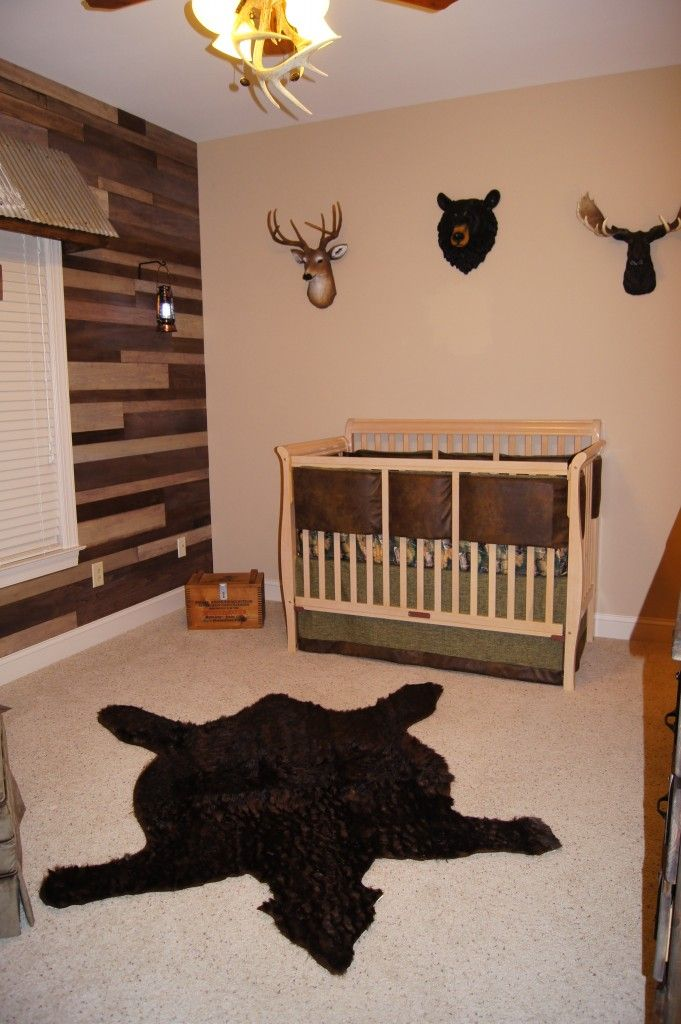 "This nursery shows a lot of creativity.  I'm not a fan of animal heads on walls but these aren't real.  Still I think I might go for an alternate.  Over all I really like the thought that went into this and think this room would ""grow"" with the baby very easily."