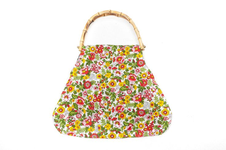 Handbag made of vintage fabric. Lovely vibrant colours in red, green, pink and yellow.