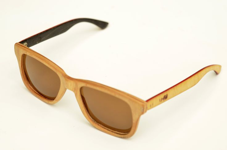 Hand made sunglasses, recycled from a element skateboard. by U-FIT/ARGENTINA