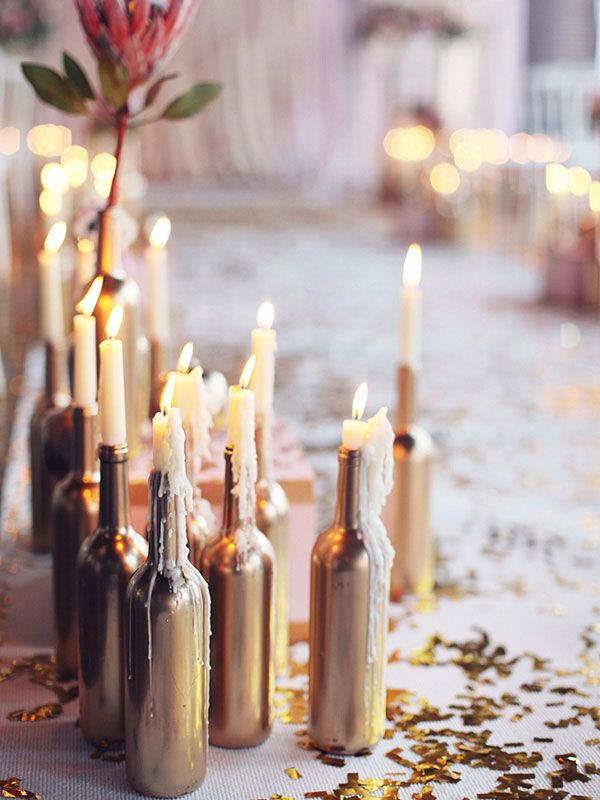 wine bottle centerpieces for wedding...like the idea of candles in them