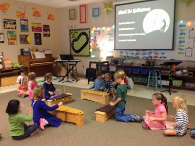 Make Music Rock!: Kindergartners on xylophones. Make a square and students make lines behind each instrument. When the first student finishes, he/she goes to the back of the line. I like this idea!